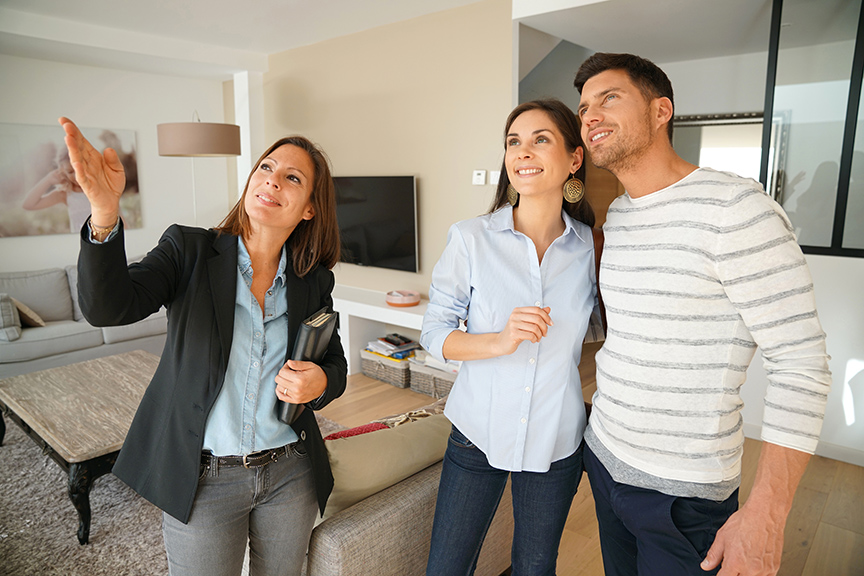 couple-with-real-estate-agent-visiting-house-for-sale