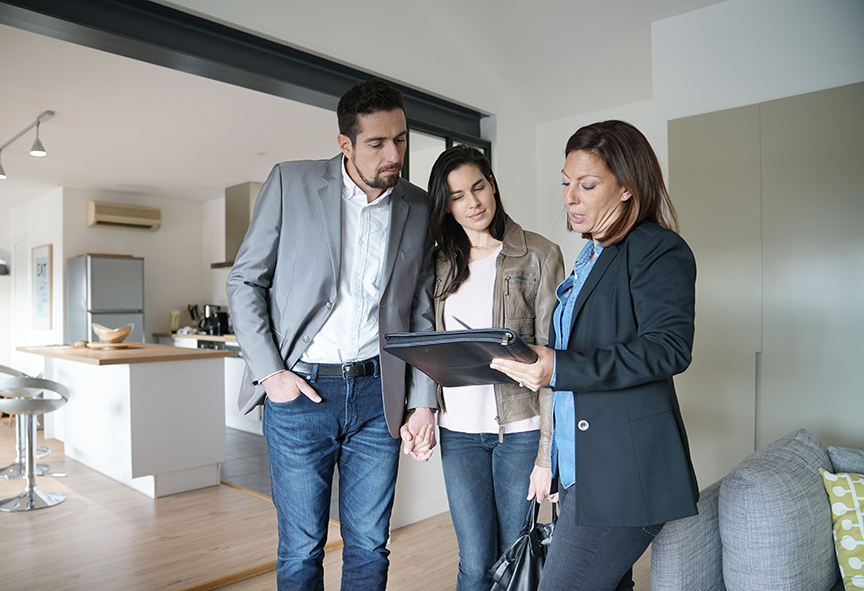 couple-with-real-estate-agent-visiting-modern-house